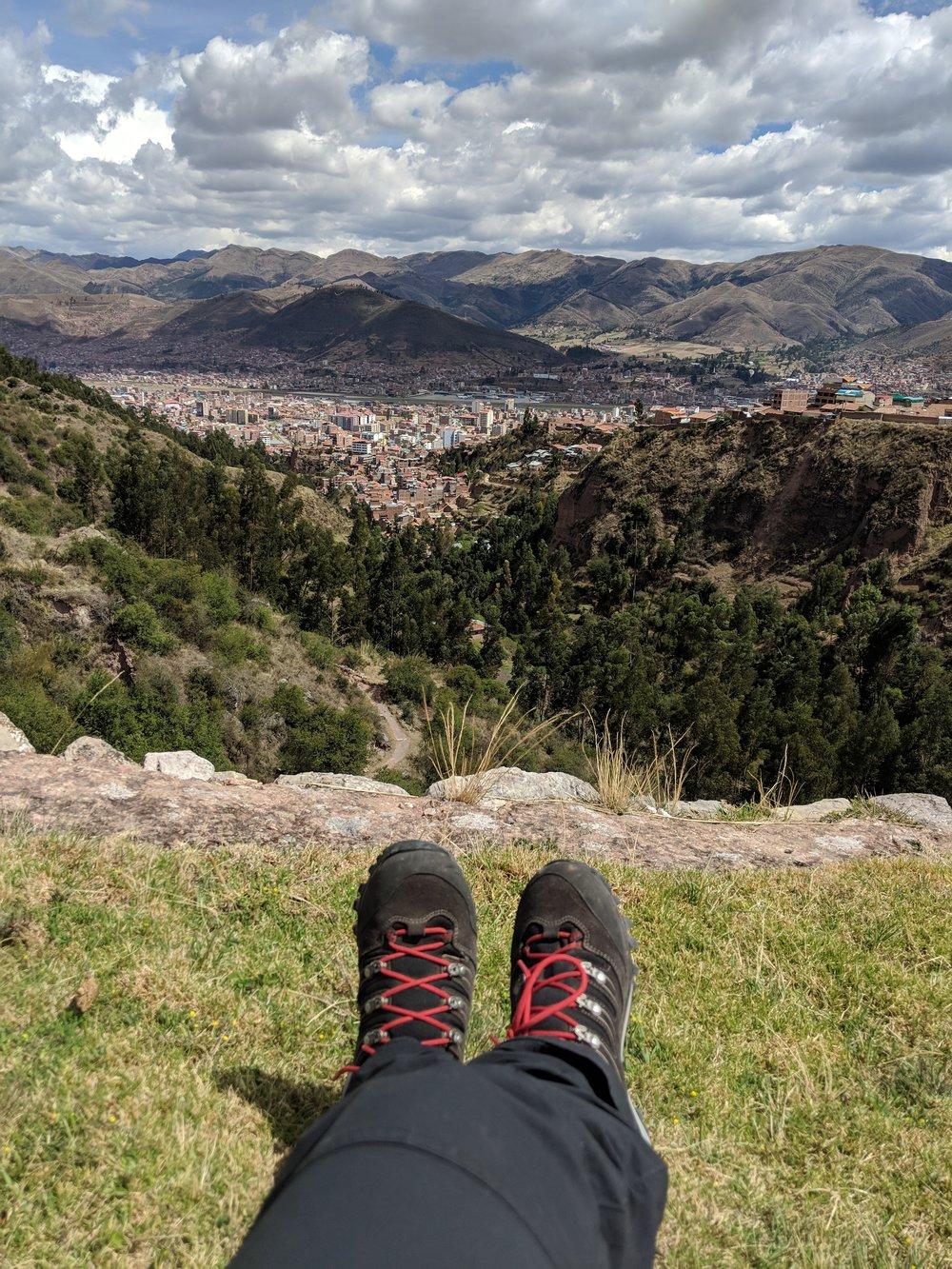 Enjoying the view of Cusco atop a surrounding hill.