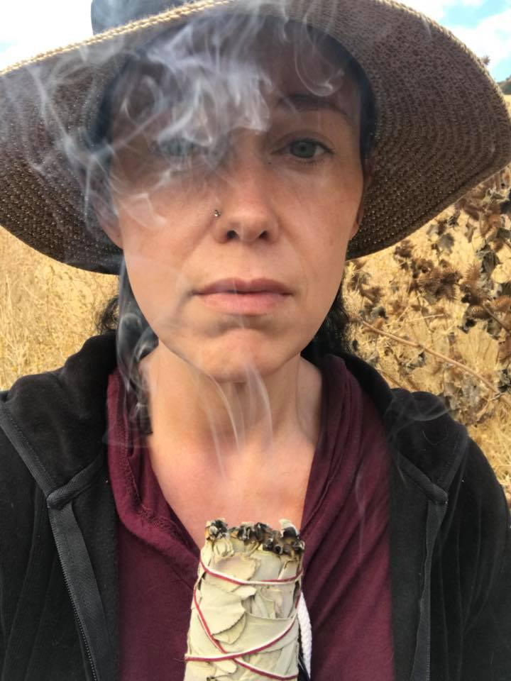 Smudging the Stewertville Trail in Antioch, CA of the bad energy that loomed from Odin's death.