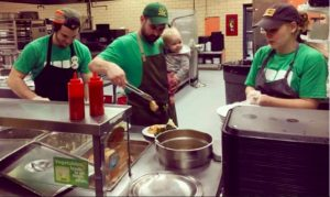 Ryan (middle) working alongside two other Brigaid chefs, Tyler Guerin (left) and April Kindt (right)