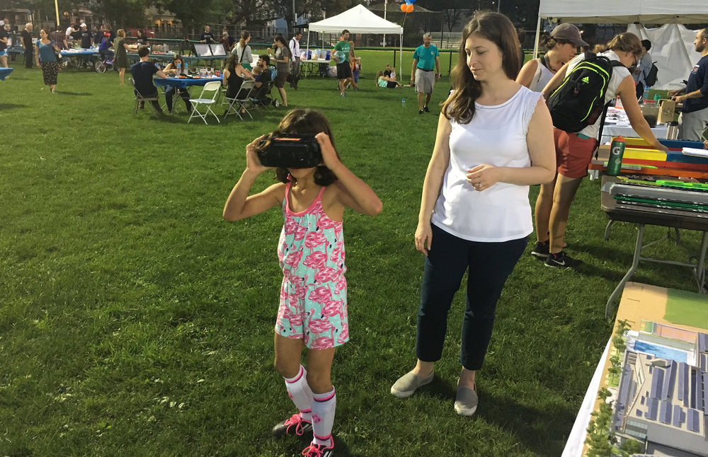 Arrowstreet's Director of Sustainability and Building Performance Kate Bubriski engages King Open / Cambridge Street Upper Schools & Community Complex students in a virtual reality experience of their future school.