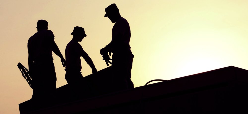 workers-construction-site-hardhats-38293.jpg