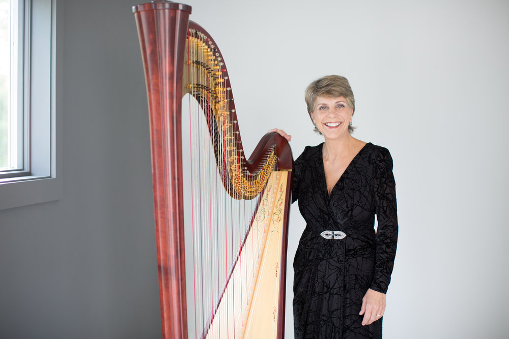 TERESA MANGO AND HER SALVI AURORA HANDMADE HARP IN PIASCO, ITALY.