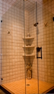 When the budget allows I love using the Walker Zanger hand made tiles. They offer texture and interest especially when simple is the desired goal. I like to add in random ( in this case 2 delft antique tiles) and always a piece of statuary. This shower is home to a concrete garden statue of St Francis and a pottery finial on the top corner shelf.