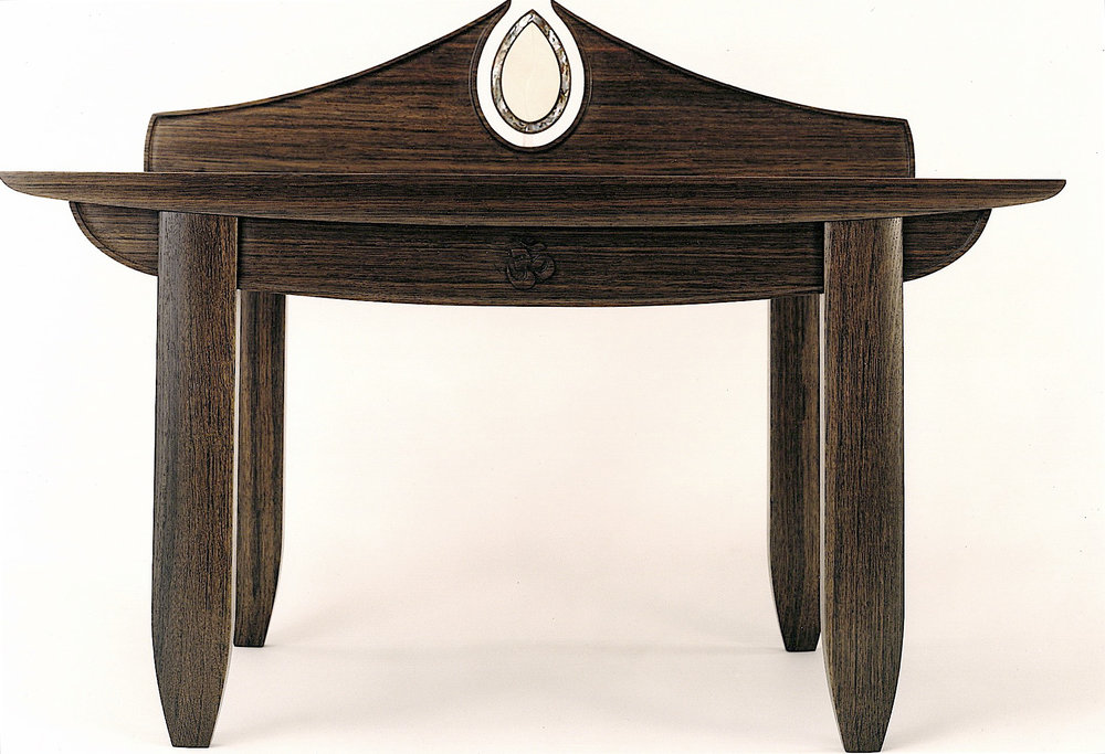 "prayer table (34""W X 19""D X 18""H , front):  Estonian bog oak with a natural oil finish, woolly mammoth tusk & green abalone details"