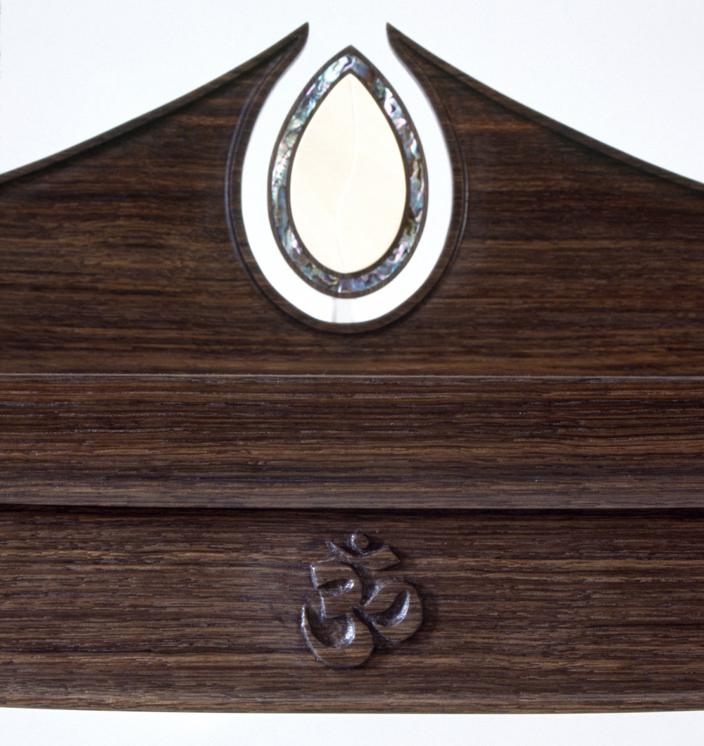 "prayer table (details):  green abalone & carved Sanskrit symbol for  ""Om"""
