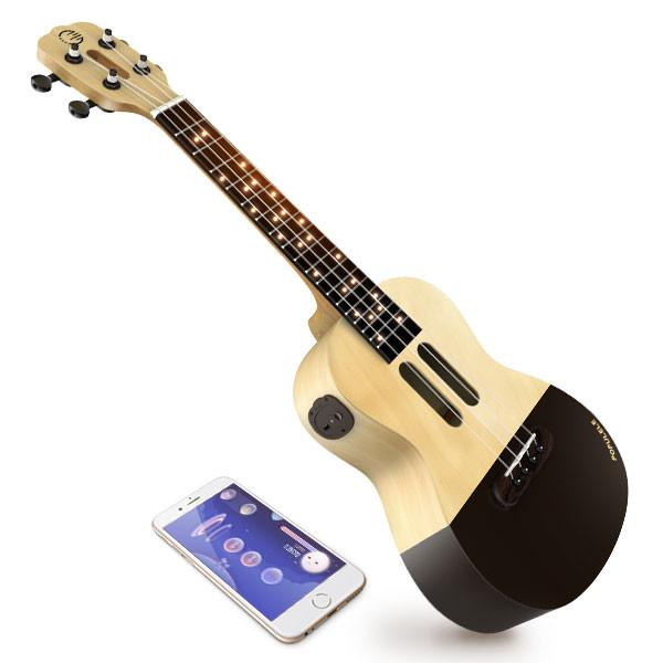 Populele Smart Ukelele : The Populele app connects via Bluetooth to teach you exactly how to use this smart Ukelele. You'll be playing your favorite tunes before the New Year! Perfect for the savvy strummer.