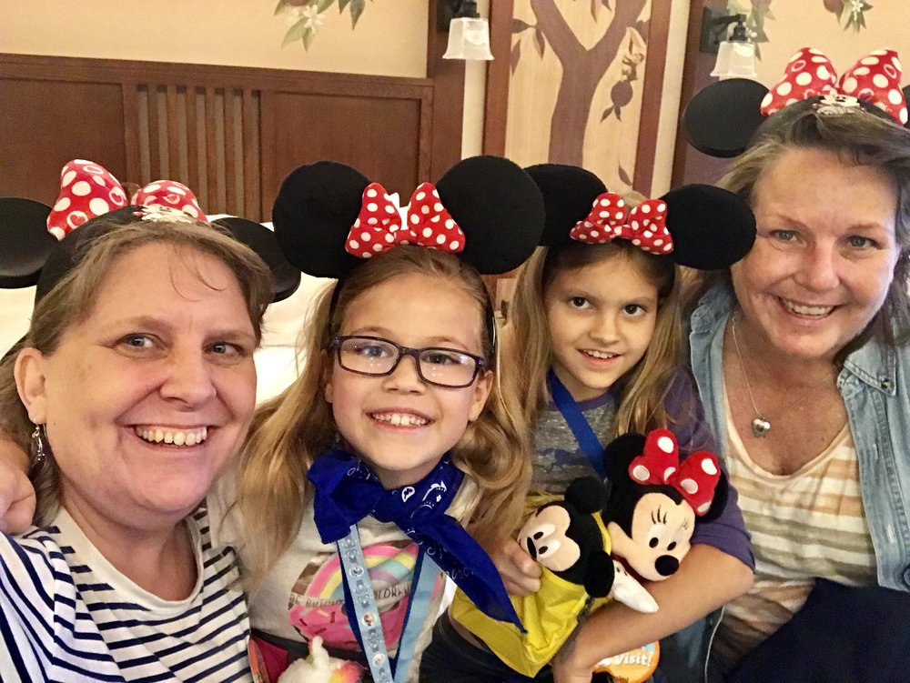 TIP: Brace your iPhone against a stuffed Minnie. Tap your Camera app. Tap the camera icon to use the front camera. Tap the timer icon at the top. Tap 3s. Tap the shutter button. Smile. You're at Disney!