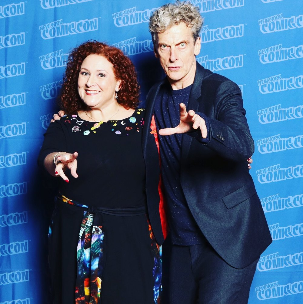 Sandra Mounts in her Ms. Frizzle/Magic Schoolbus Galaxy dress with Peter Capaldi.   Photo credit: Heroicouture