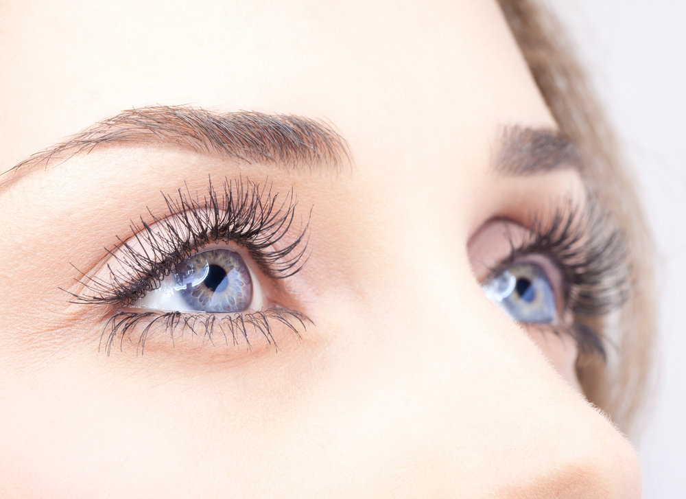 A close-up of a woman's eyelash extensions