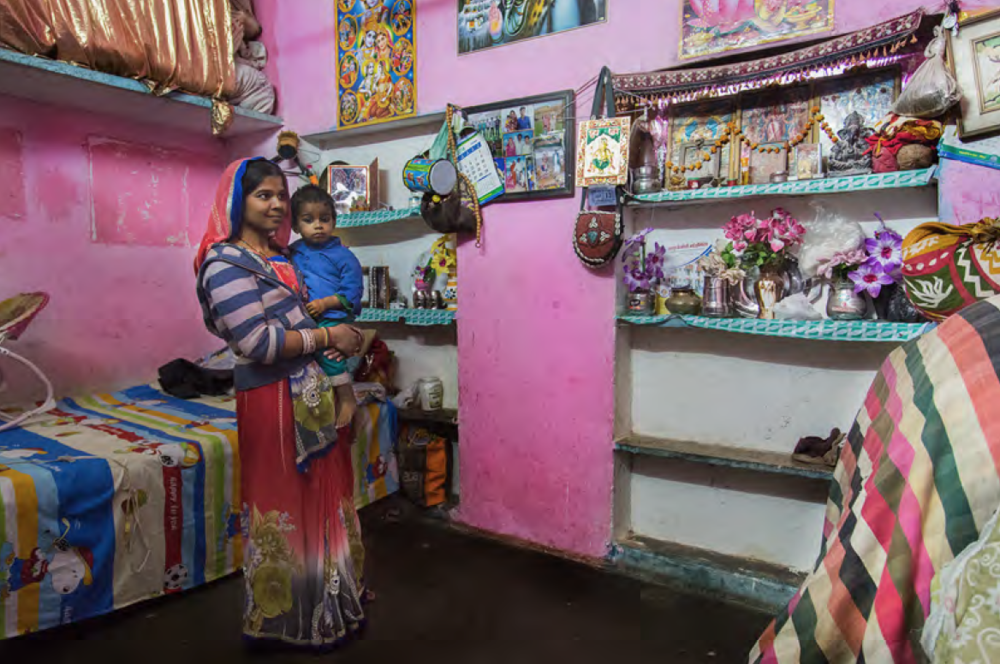 Preeti is very young and has been married very early at the age of 15, she has 3 children by now living together with her mother and husband in a house of two rooms. This family is very religious and have decorated their home accordingly, they even have a small altar built by the entrance.