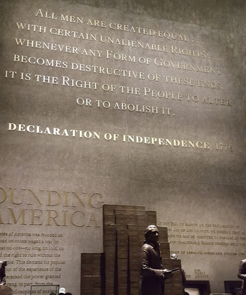 "Thomas Jefferson, with the names of each slave he owned on bricks behind him, in the ""Paradox of Liberty"" display."