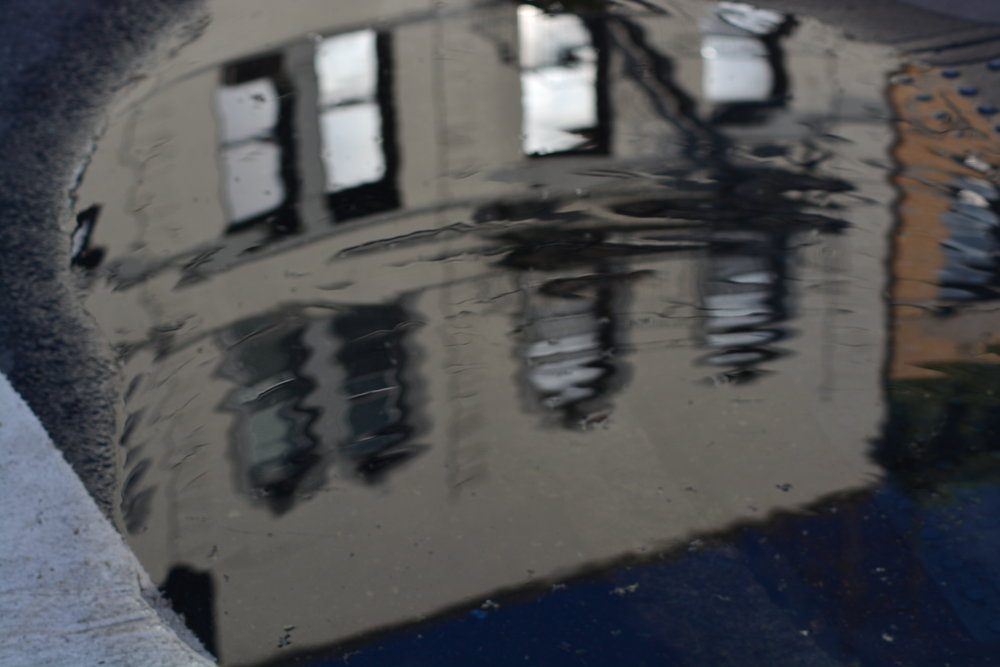Apartment Building in a Puddle