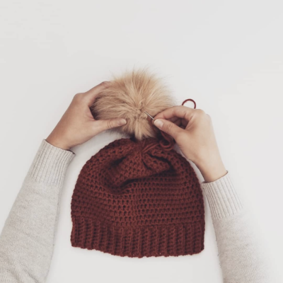 CROCHET BEANIE WITH FAUX FUR POM POM