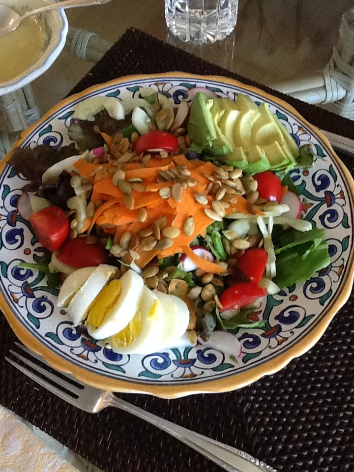 A very Alkaline salad for lunch today.   Found lots of beautiful produce at the farmers market. This is a mixed green salad with sliced cucumber, carrots, sliced radishes, a few tomatoes, celery,   A hard boiled egg, ½ of an avocado, and toasted pumpkin seeds on top.   I served it with a basic vinaigrette using 1 tsp. French mustard, 1Tbsp apple cider vinegar and 3Tbsp. Olive oil. Mix together with a whisk until creamy.