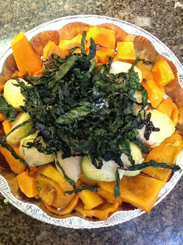 Butternut squash, Brussel sprouts and crispy Kale.     I had a fun day at the farmers market and put together this dish. It's a little time consuming but very worth it.   First, preheat your oven to 350 degrees.   Line a baking pan with parchment paper or tin foil.     1 butternut squash, peeled and chopped into 1 inch squares.   2 tsp. fresh or dried thyme.   1 Tbsp.  plus 2 tsp. olive oil.   12 Brussel  sprouts, cut in half  8 - 10 leaves of dinosaur kale, veins removed.   Salt and pepper to taste.     Slice the kale into strips. place the kale on the baking pan and coat with 2 tsp. of olive oil and salt and pepper.  Place in the oven. Cook for 15-20 minutes until crispy and bright green. Transfer to a paper towel. Set aside.     Raise the oven to 375 degrees.   Place the squash pieces on the baking tray, drizzle with 1 TBSP of the olive oil. Sprinkle  the thyme, a little salt and pepper and mix. Bake about 30 minutes until the squash is tender.   While the squash is in the oven, simply steam the Brussel sprouts. Place on a steam rack, place in a pot, add water, cover and cook for 8-10 minutes, until done.     Place the squash in a serving bowl. Arrange the Brussel sprouts over the squash. Top with the crispy kale.