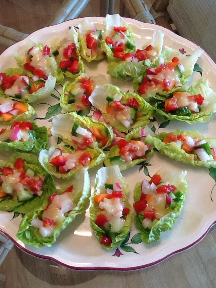 Little Gem Salad    This salad is a fun way to present a salad for a party or large crowd. I bought some  little Gem Lettuce at the farmers market. I chose this slettuce because it holds the vegetables well and it's easy to just pop in your mouth in one bite. It's a fun presentation and easy to make. You can use any salad vegetables you like.     2 radishes  2 small cherry tomatoes  1 small cucumber  2 carrots  1 red bell pepper    Dress with 3 Tbsp. of olive oil and 1 tsp. of either apple cider vinegar or l tsp. Of  fresh  lemon juice.