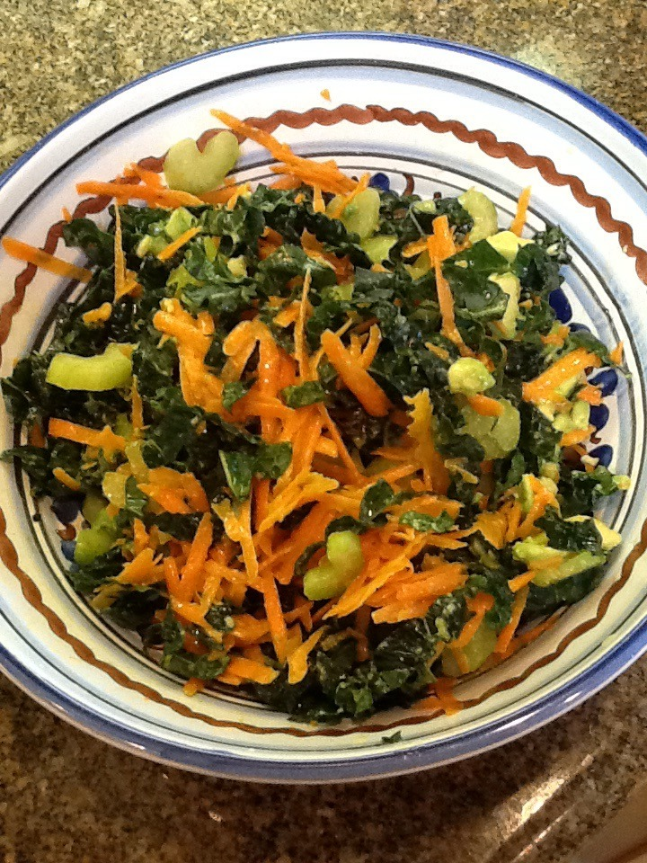 Kale Salad  This is a delightful fresh tasting salad. I made it today for lunch. A friend joined me and we ate the whole thing. It was just so yummy.     1 bunch of dinosaur kale  3 stalks of celery, sliced thin  1 carrot, grated  1 avocado  ½ of a lemon  1 tsp. Dijon mustard  1 Tbsp. Apple cider vinegar  3 Tablespoons olive oil.     Take the kale off the stems. Chop it into small pieces. Place in a salad bowl and squeeze the ½ of lemon over it. Let it sit while you prepare the rest of the salad.   Slice the celery and grate the carrot. Add to the bowl. Dice up the avocado and add to the salad.   Mix the mustard with the apple cider vinegar. Slowly whisk in the olive oil. It will emulsify into a nice thick salad dressing. Pour over the salad, mix and serve.   You can add salt and pepper to your liking.   Note: You can make and dress this salad up to 3 hours before serving.