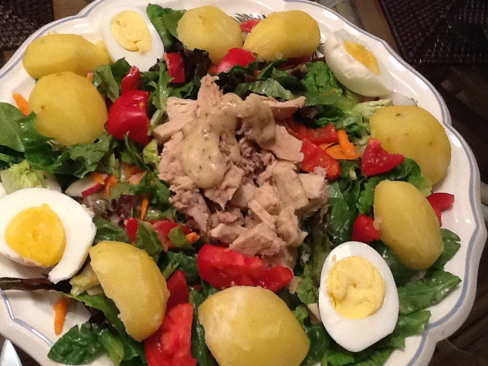 A mostly alkaline  salad. I was having company and decided to make version of the classic Salad Nicoise. I served it on a large platter so everyone could choose what they wanted. Since I was the only one eating 80/20 alkaline foods, I chose accordingly. I skipped eating the eggs     I felt like it was a Chopped (TV  cooking show) challenge.   I had invited a friend over for dinner and just decided to use what I had in my fridge and pantry.   Fun to do. Try it some time.     Place a large pile of mixed greens on a platter. I mixed in some raw baby spinach.   I placed 1 can of tuna in the middle. A few boiled potatoes, some grated carrots and sliced radishes. 1 tomato 2 hard boiled eggs and 1 avocado.   Dressing was a mustard vinaigrette.   1 tsp. Dijon mustard  1tsp. apple cider vinegar  3 Tbsp. Olive oil