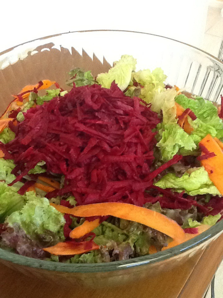 Beets are such a fun treat. You do not always have to cook them. I love raw grated beets and I incorporated them into a fun colorful salad.     Fill your bowl with lettuce. I used a vegetable peeler to peel the carrot strips.  Peel the beet to remove the hard outside. Then grate the beet and place in the bowl.   Add 2 stalks of celery.   Dressing  1 tsp. Apple cider vinegar   3 Tbsp. Olive oil.