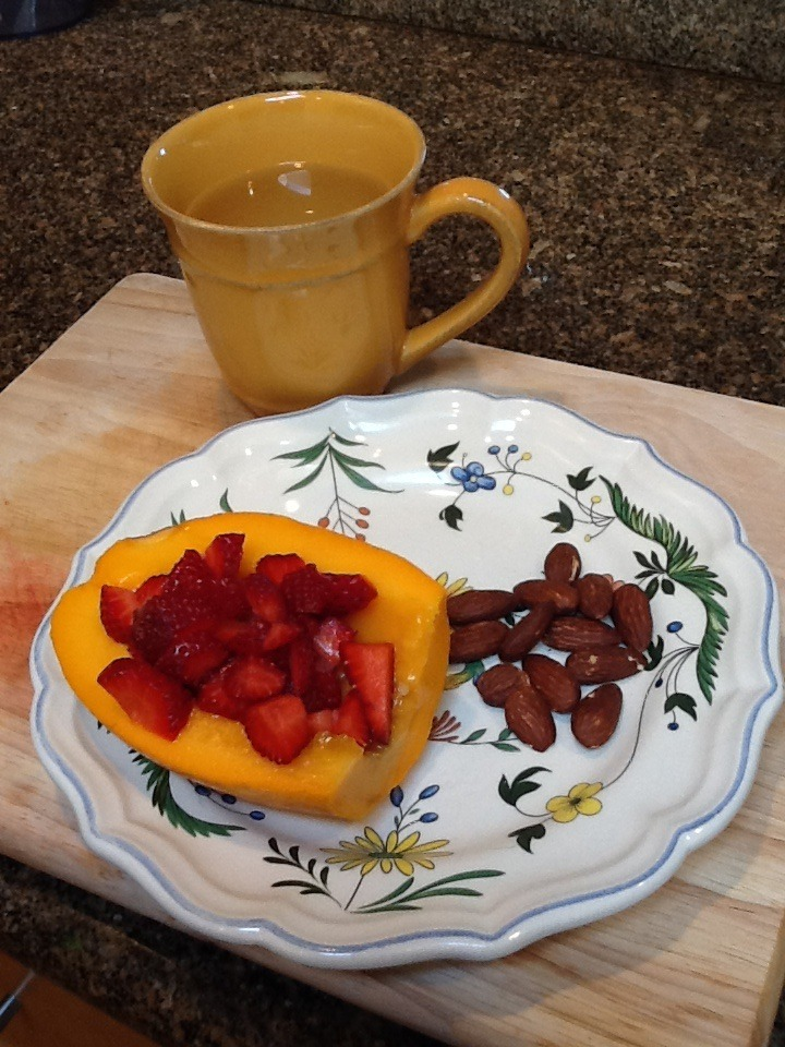 My breakfast this morning.     I love to start off my day with a cup of ginger tea. I prefer to use fresh organic ginger. It is so delicious and easy to make. It is also known to have strong anti inflammation properties.   I start by peeling the ginger, then I cut a few slices off and put them in a cup of boiling water. Let steep for just a few miutes and then it's time to enjoy the wonderful taste of fresh ginger tea.     Slice a papaya in half. Remove the seeds. Squeeze on little lime juice. Add about ½ cup  of sliced strawberries. A small handful of almonds complete this meal. This is also a perfect afternoon snack.