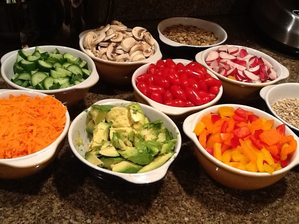 Create your own salad bar, invite your friends over and wow them. It's just a fun way to serve a salad. Just be creative and place your favorite salad components into bowls.   I used, grated carrots, cucumbers, mushrooms, radishes, avocado, red and orange bell peppers, tomatoes, chopped celery, toasted sunflower seeds and toasted pumpkin seeds.     Serve with a big bowl of your favorite greens.