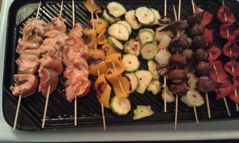Here is the finished dish. I added a few skewers.  of fresh salmon. To finish off the zucchini, I took them off the stick and placed them directly on the grill.  I served this with a pot of brown rice and it was a big hit.