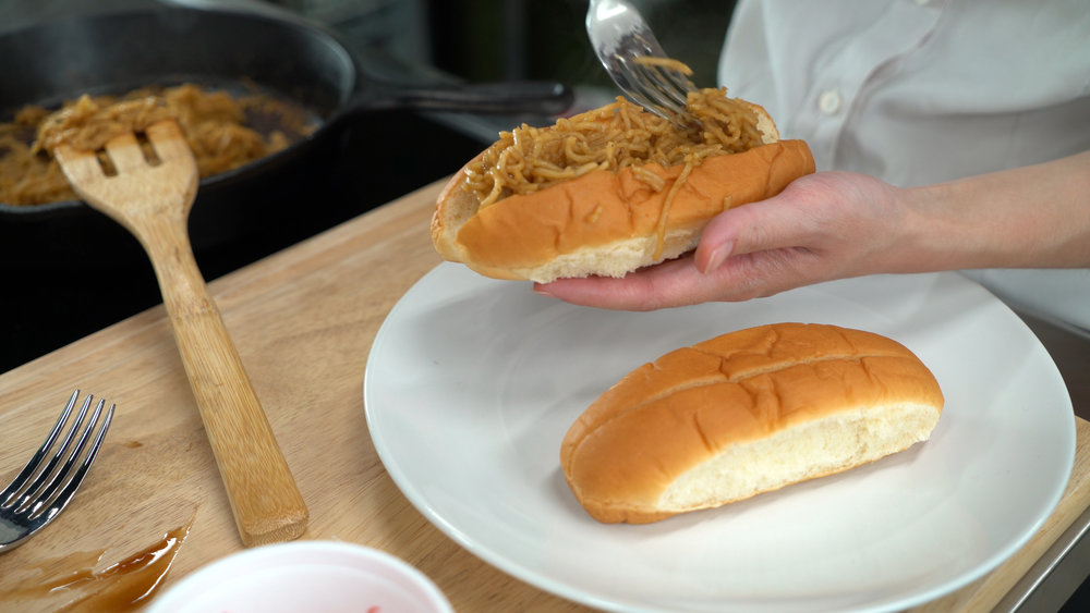 step 4. add noodles to hot dog buns