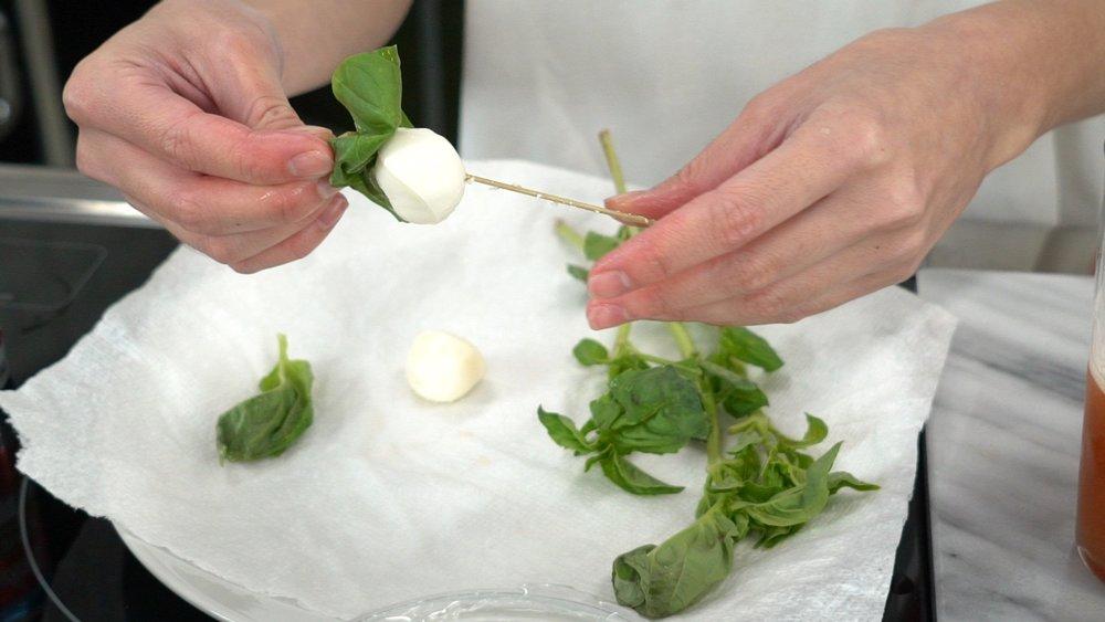 step 8 prepare garnish of basil leaf and mozz ball