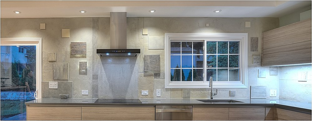 Unique and one of a kind kitchen backsplash wall designed to compliment designer cabinets and counter top.
