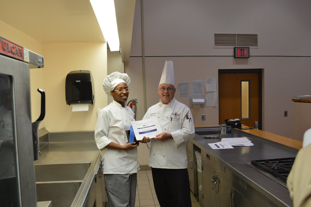Chef Chuck Baux presents Natasha Bankston Nevels with1st Place for her Tex-Mex Chicken Salad