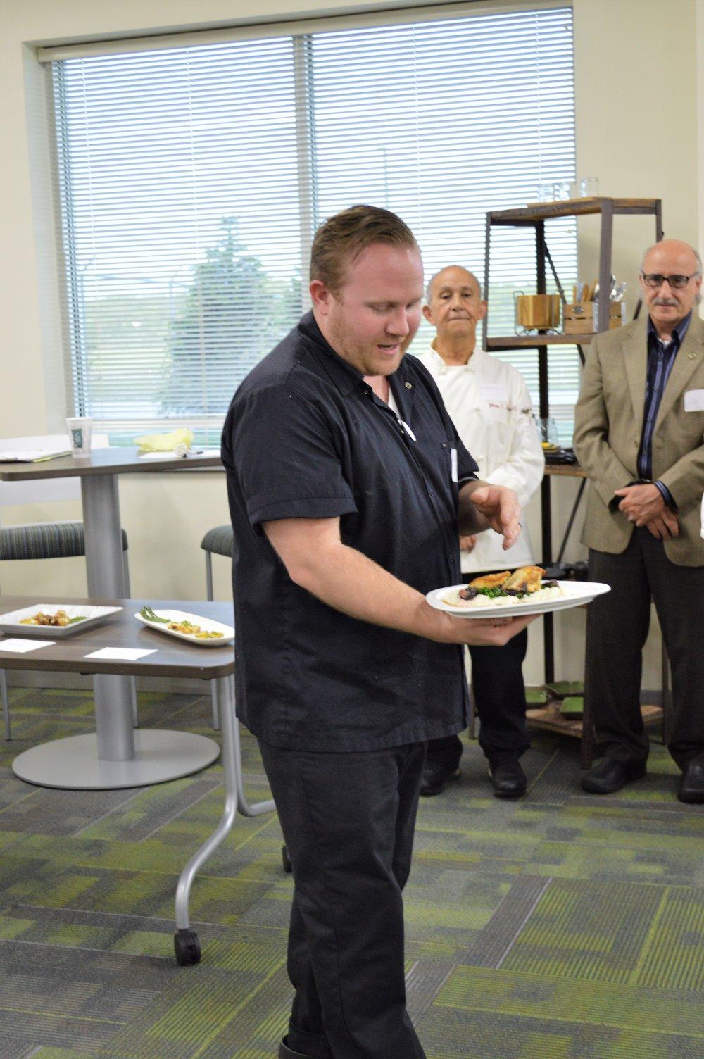 Jared Lordon presenting his dish.JPG