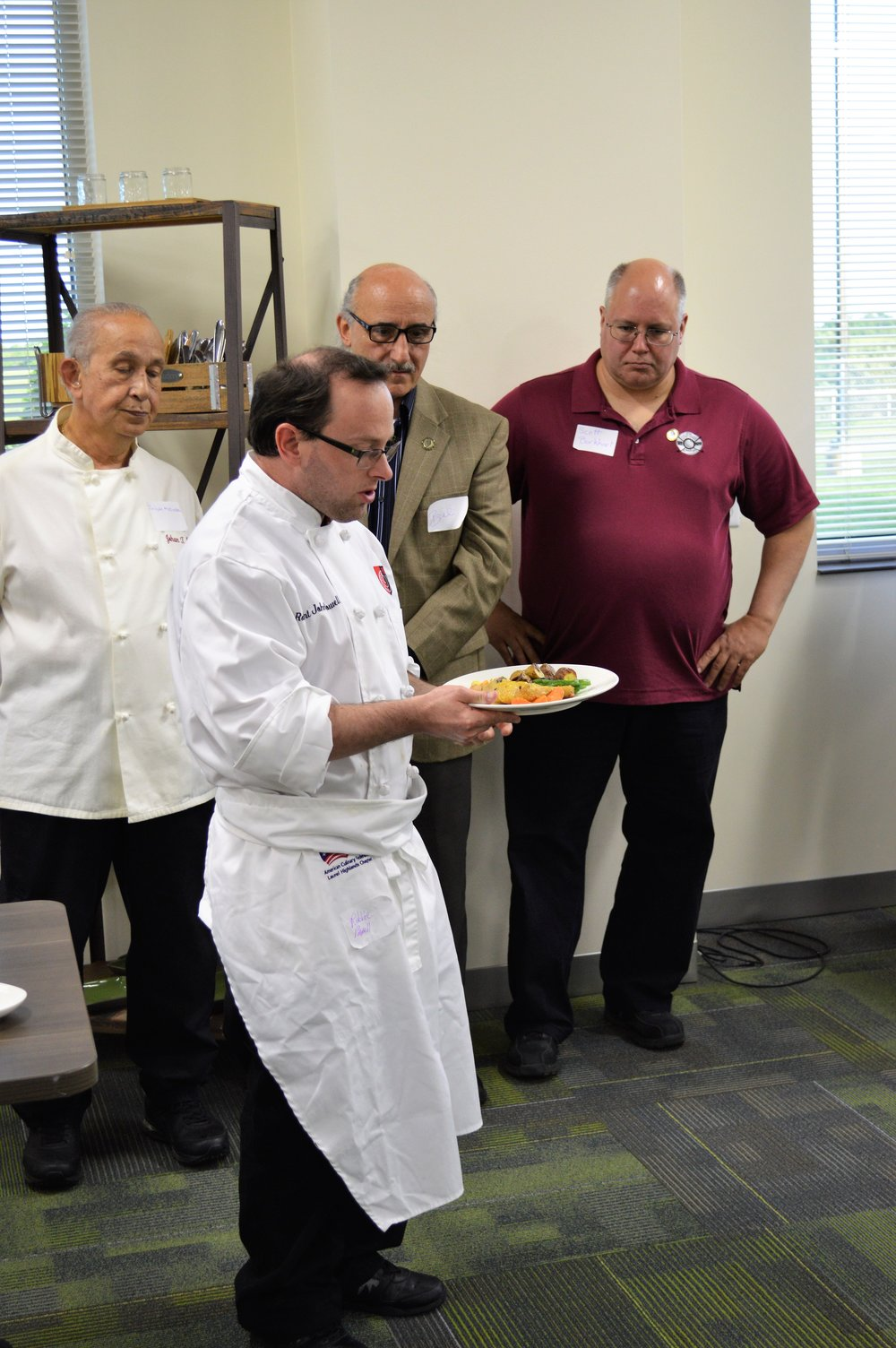 Robbie Powell presenting his dish.JPG