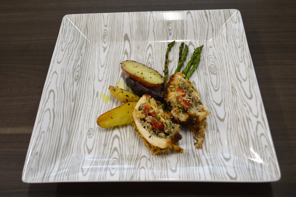 Trisha Butler - Mushroom, tomato, tenderlin, basil stuffed chicken breast with grilled asparagus and toasted fingerling potatoes.JPG