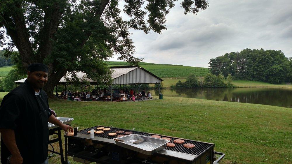 Photo at the grill is Jolando Hinton.  Jolando & Mark Zeigler catered the picnic, photo by Scott Burkhart.jpg