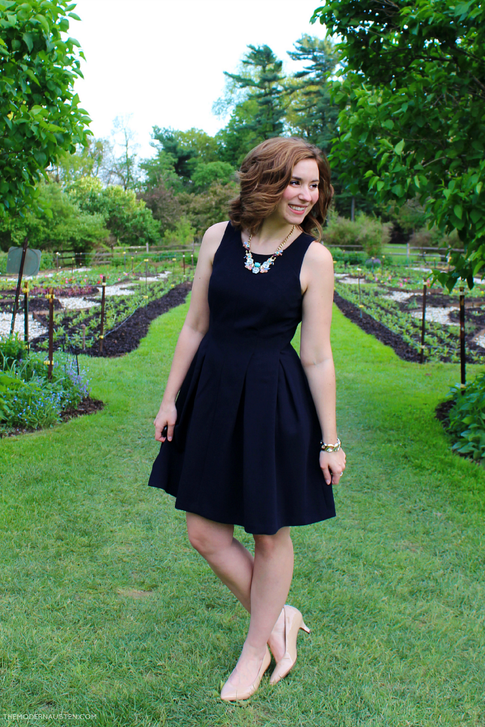 Classic navy outfit with statement necklace