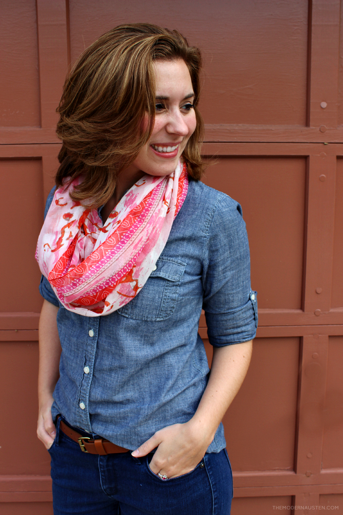 Use a patterned scarf in a bright hue as a statement accessories