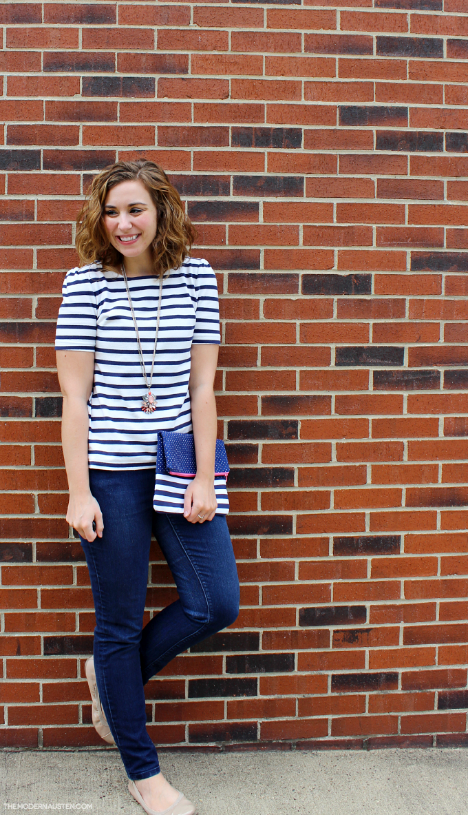 Add a fun striped clutch to any outfit
