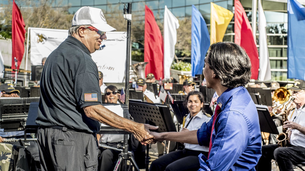 Ricardo Franco greeting the Sounds of Freedom Band during the 2017 Fresno Veterans Day Parade