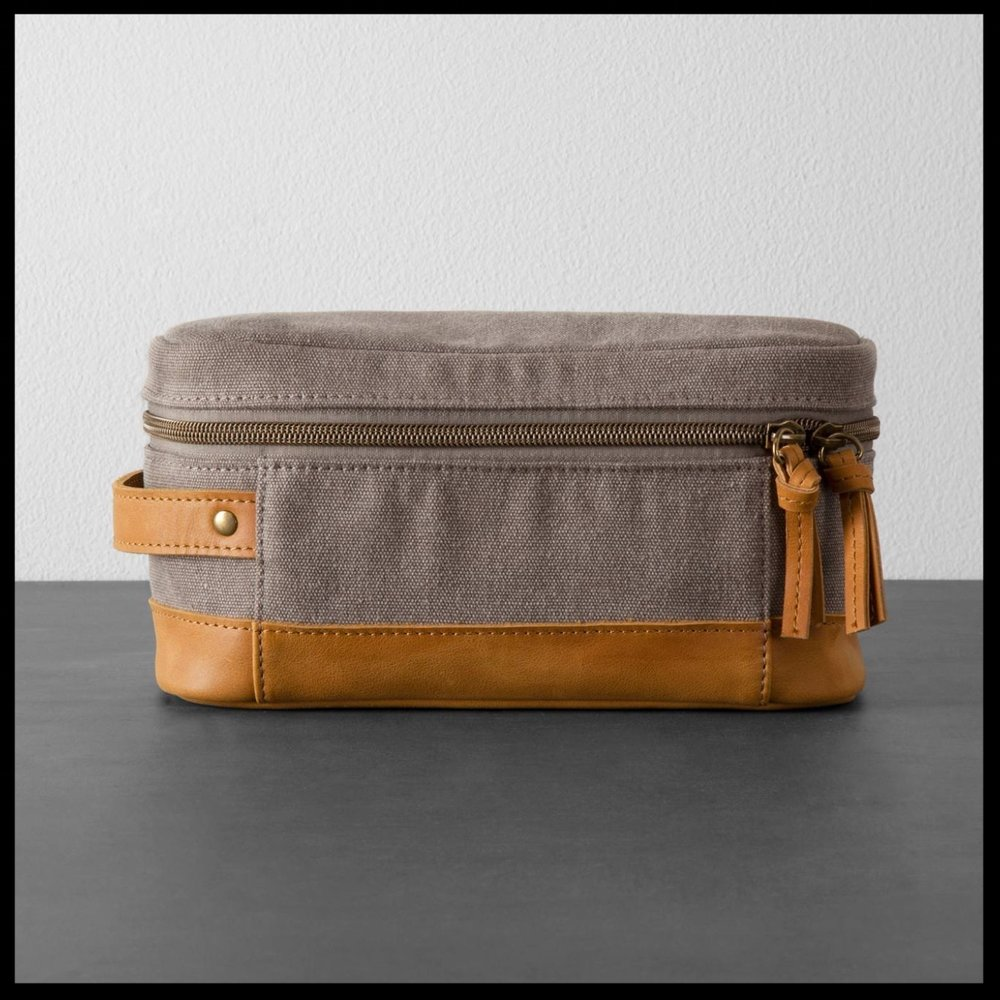 Canvas & Leather Toiletry Bag Hearth & Hand™ - $19.99 - Every guy needs a good toiletry bag! This Canvas and leather bag by Hearth & Hand will not disappoint. Your man will thank you!