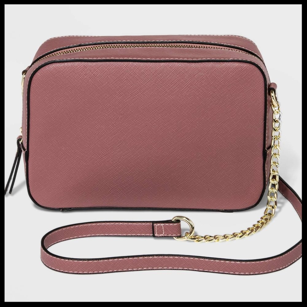 Camera Crossbody Handbag - A New Day™ - $27.99 - An absolutely timeless design, this crossbody handbag can carry all of her essentials. The long shoulder strap makes it extremely easy to wear. This exclusive Camera Crossbody Handbag comes in seven beautiful colors. Perfect for the fashionista in your life.