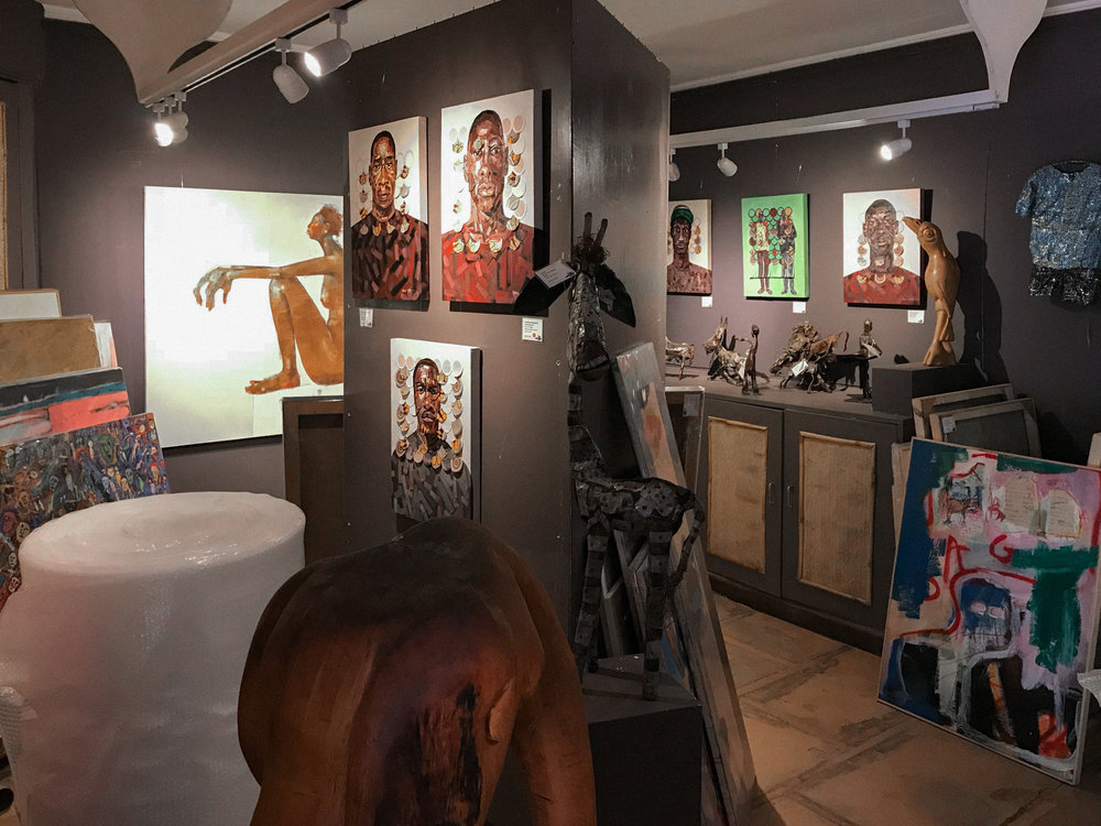 The walls are packed with stunning works - notably Peter Ngugi, Ehoodi Kichapi, and Olivia Pendergast pictured here.