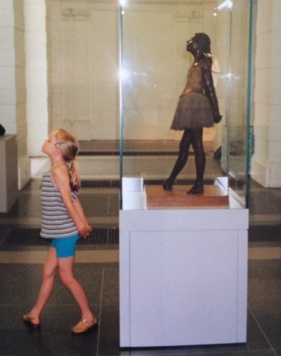 Lydia when she was about 8 years old, at a museum with Degas's Little Dancer.