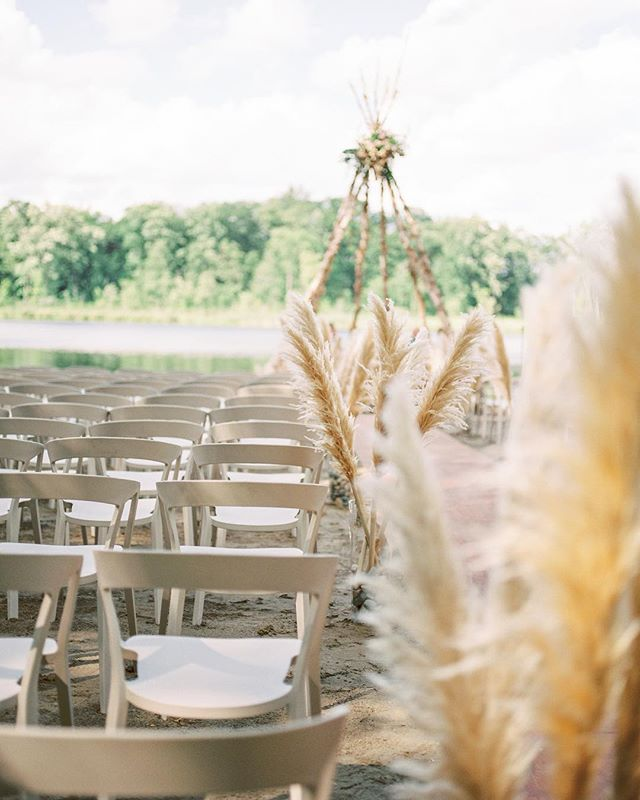 Pampas grass and perfect weather waiting for their cue to greet guests . . . Furniture rental: @12thtable // Photography: @savanphotography // Teepee: @pleasant_view_construction // Event planning and design: @alex_buchanan_co // Florals: The Weed Lady