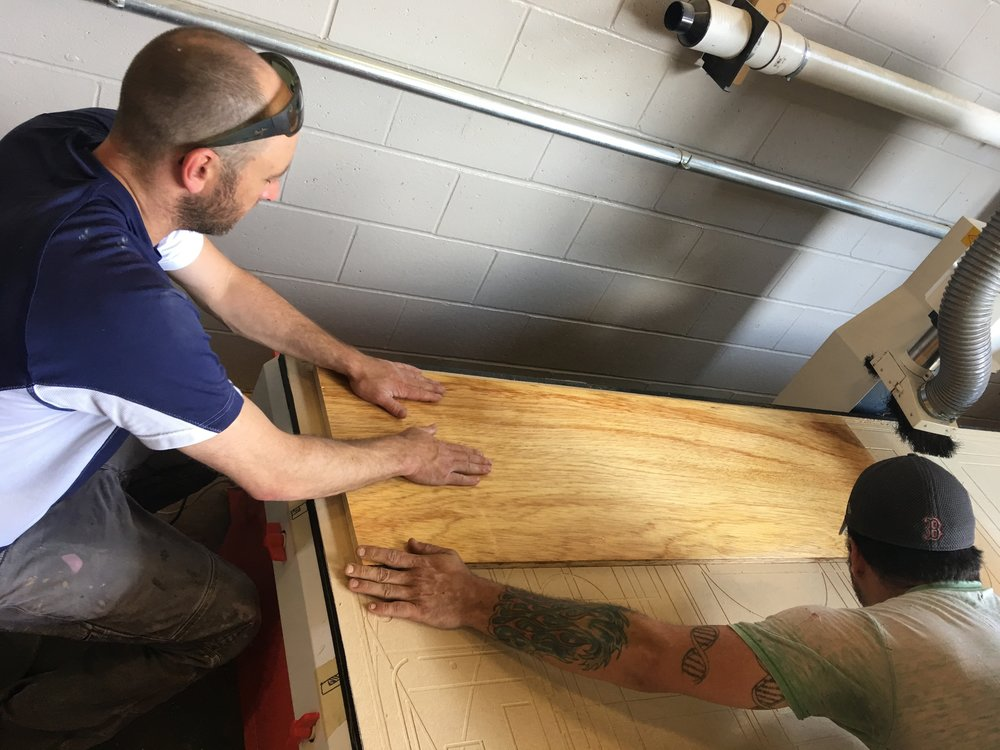 Dave and Mark are getting ready to cut part of the bar top. We were very excited.