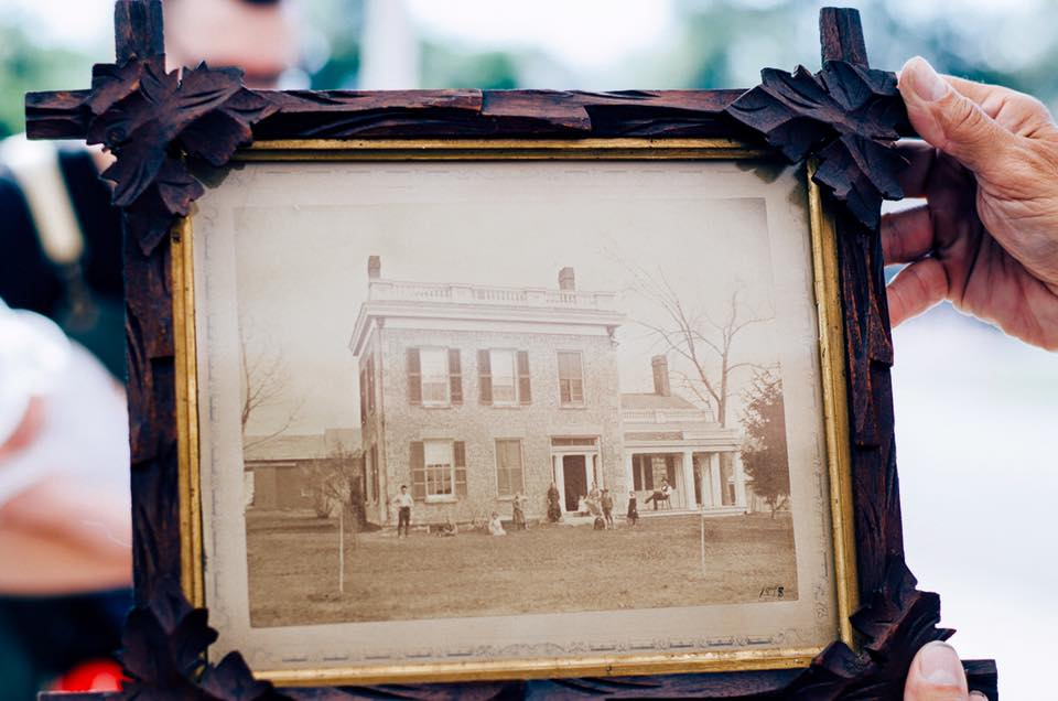 A photograph of the house from the 1800s, when it was still surrounded by farmland.