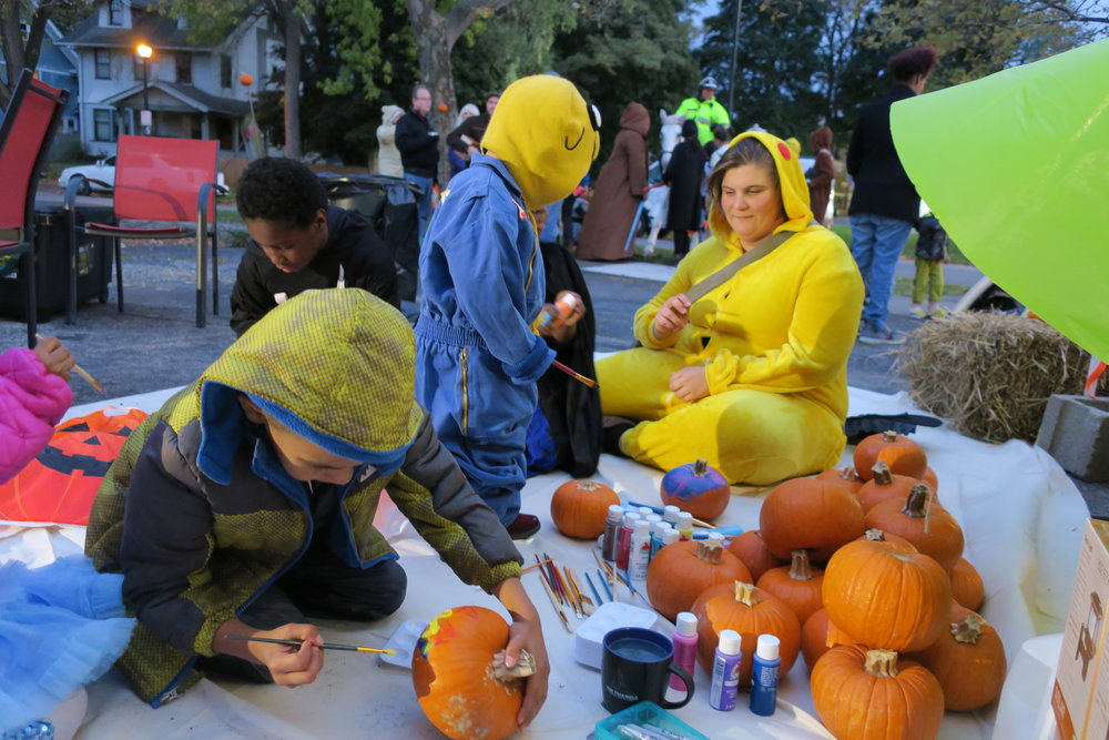 Triangle resident Julie--I mean, Pikachu--helps kids paint pumpkins.