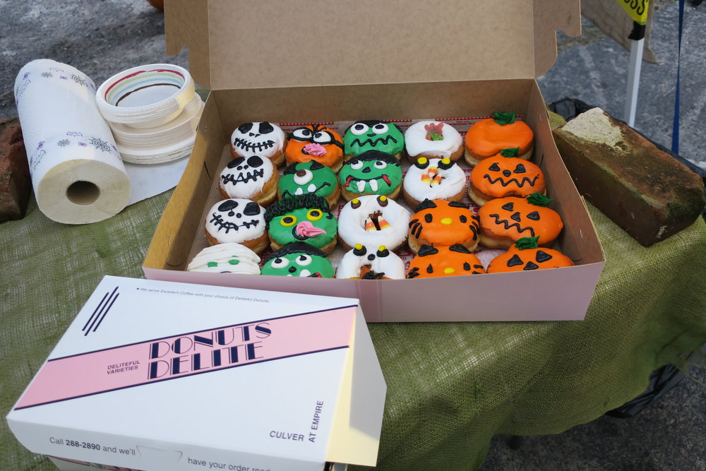 Spooky treats courtesy of Donuts DeLite, members of the Triangle Merchants Association.