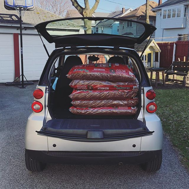 "When your Triangle Neighborhood co-chair (@mikeyvargasrodriguez) drives a Smart Car and has to buy 6 bags of mulch and a box of flower bulbs for Clean Sweep! It's a ""make it work"" moment! (FYI I know you looked back and counted in the photo, 1 bag was in the passenger seat). The Triangle Clean Sweep is from 8am to Noon. Volunteers can meet at the Corner of Culver and Garson by the ""Dollar General"" sign/flower box. There will be T-Shirts and tools available to pick-up there! #rochesterny #cleansweep @northwintonvillage #trythetriangle"
