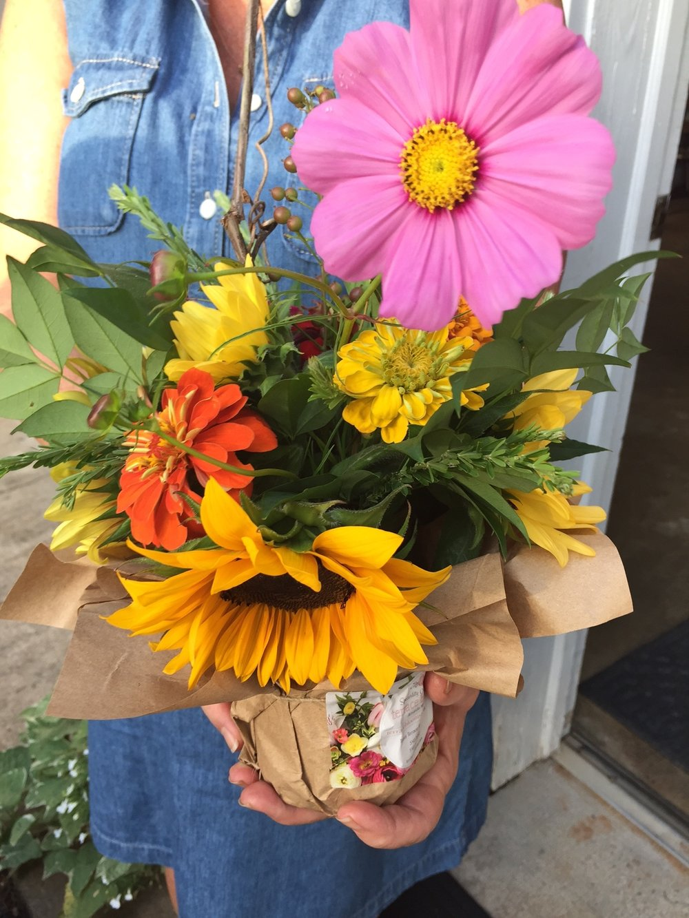 This beautiful bouquet contains sunflowers and a unique variety of zinnia's and other flowers