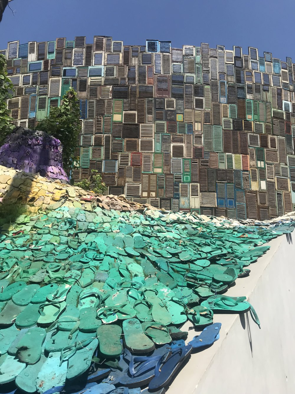 Flip flops that were found on the beach and recycled to create this incredibly cool entrance to Potato Head Beach Club